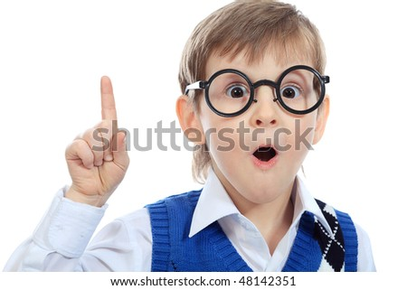 Portrait of a little smiling boy in a funny glasses. Isolated over white background.