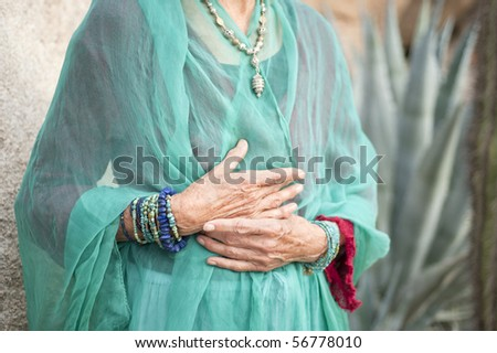 Portrait of a lovely and graceful senior woman's hands wearing jewelry by Art Medicine Adornment.