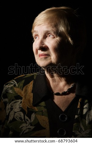 Portrait of a lovely old woman over black