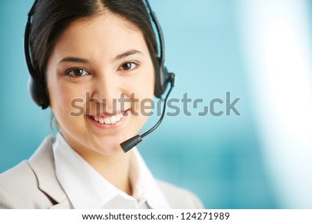 Portrait of a lovely receptionist wearing a headset