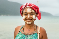 Portrait of a Malagasy woman with her face painted, Vezo-Sakalava tradition, Nosy Be, Madagascar.