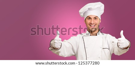 Portrait Of A Male Chef With Double Thumb Up Sign On Pink Background