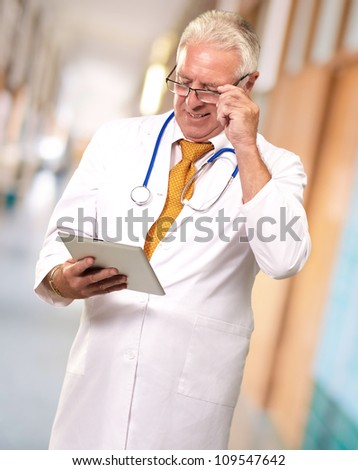 Portrait Of A Male Doctor Holding A Tab, Indoor