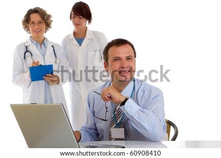 Portrait of a male doctor with two of his co-workers