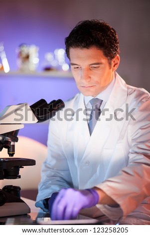 Portrait of a male health care professional in his working environment.