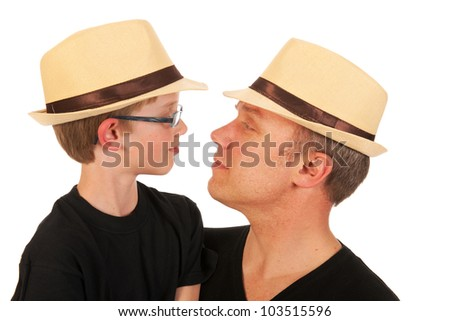 Portrait of a man and a little boy with straw hats