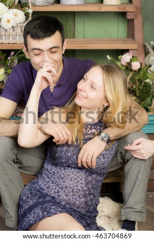 Portrait of a man and a pregnant woman. Wife touches her husband by the nose, and joyful emotions.  #463704869