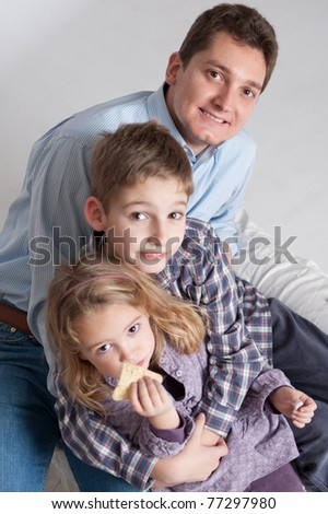 Portrait of a man and his two children, boy and girl