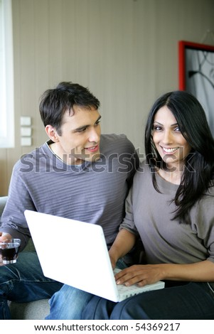 Portrait of a man and woman with a laptop computer