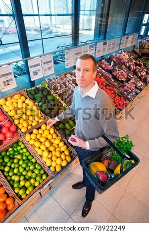 Portrait of a man buying fruits in the supermarket