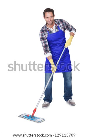 Portrait of a man cleaning floor. Isolated on white