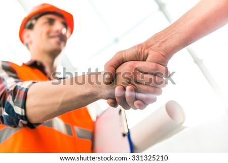Portrait of a man construction builder in yellow helmet and vest the office center #331325210