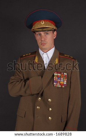 Portrait of a man dressed in a military uniform, with his hand inside his jacket