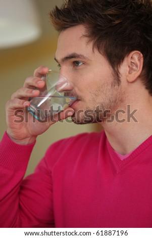 Portrait of a man drinking water