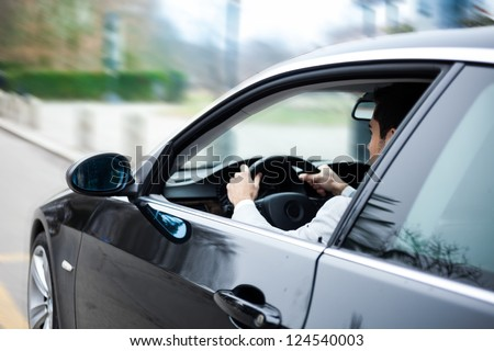 Portrait of a man driving a car #124540003