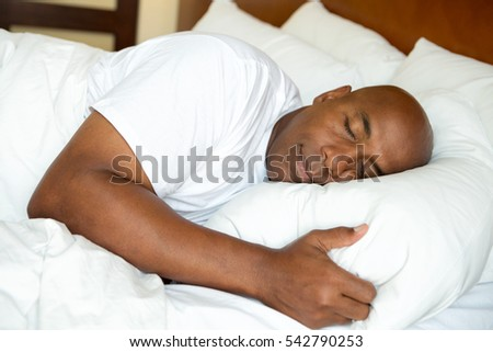 Portrait of a man getting a good nights sleep.