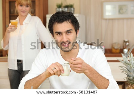 Portrait of a man having breakfast