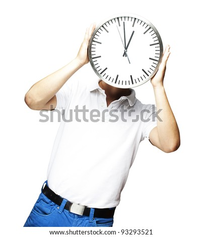 portrait of a man holding a clock against a white background