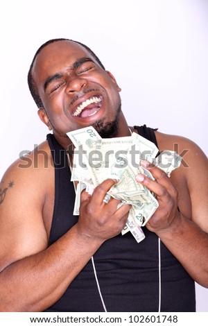 Portrait of a man holding cash.