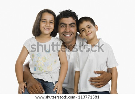 Portrait of a man hugging his children