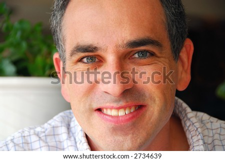Portrait of a man in a cafe