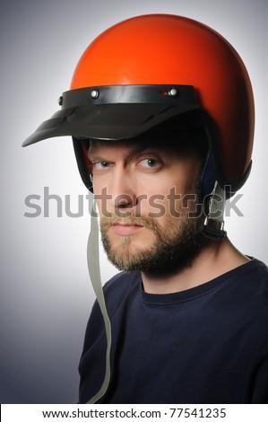 Portrait of a man in a old motorcycle helmet