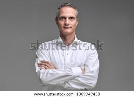 Portrait of a man in a shirt on a gray background. #1009949458