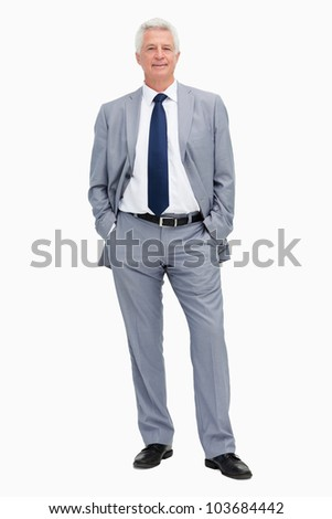 Portrait of a man in a suit with hands in the pockets against white background