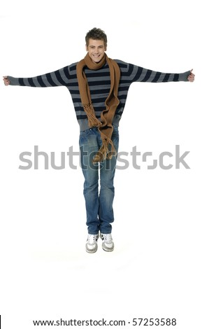 Portrait of a man in casual clothes jumping with scarf around his neck