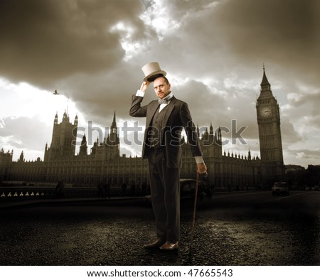 Portrait of a man in elegant suit standing in front of the Big Ben in London