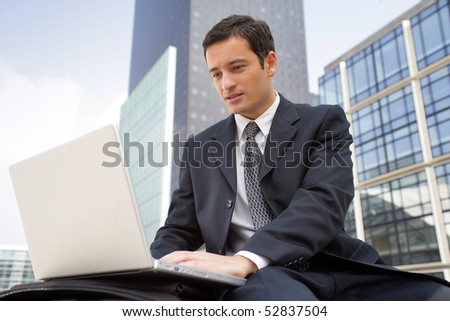 Portrait of a man in front of a laptop computer