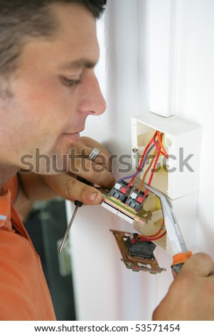Portrait of a man installing a switch - stock photo