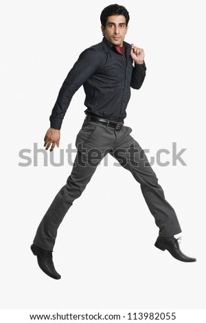 Portrait of a man jumping against a white background
