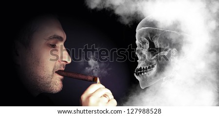 portrait of a man lights a skull on a dark background