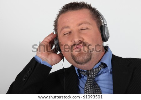 Portrait of a man listening to music