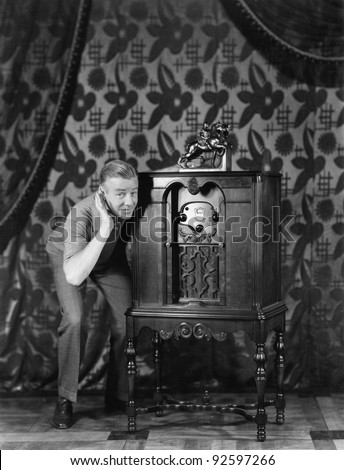 Portrait of a man listening to music from a radio and smiling