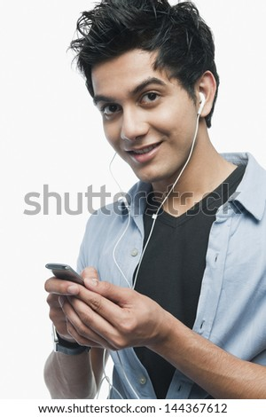Portrait of a man listening to music on iPod