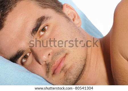 Portrait of a man lying, head on pillow