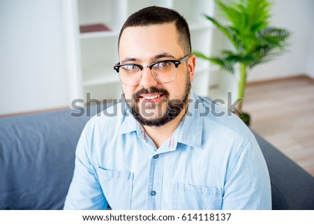 Portrait of a man on couch - Shutterstock ID 614118137