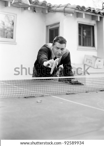 Portrait of a man playing table tennis