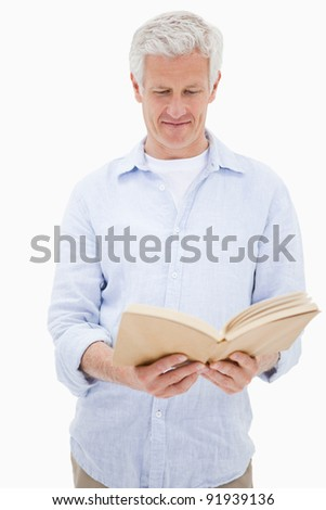 Portrait of a man reading a book against a white background