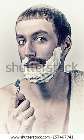 Portrait of a man shaving in vintage style