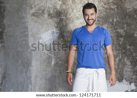 Portrait of a man smiling in front of a rock