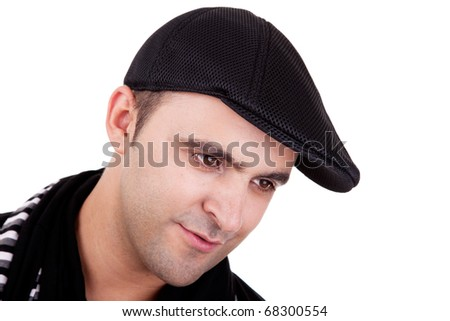 Portrait of a man smiling with his black hat, isolated on white. Studio shot