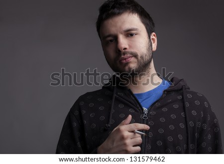Portrait of a man smoking cigarette