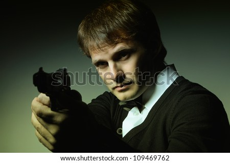 Portrait of a man with a gun