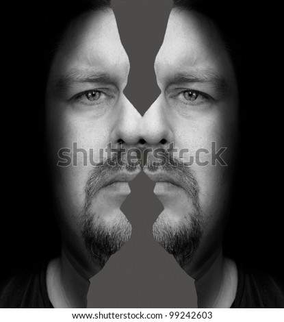Portrait of a man with a sad look and split head in Rorschach style