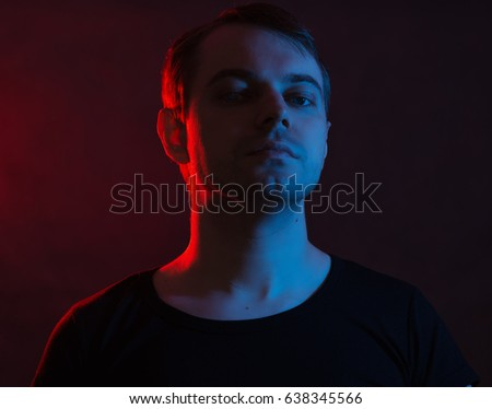 Portrait of a man with colored light and dark background. #638345566