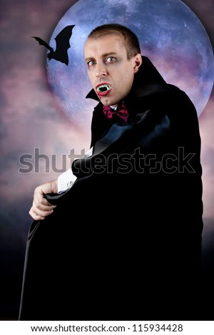 Portrait of a man with Count Dracula style make-up. Shot in a studio.
