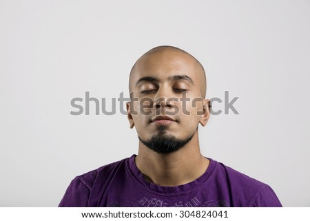 Portrait of a man with eyes closed
